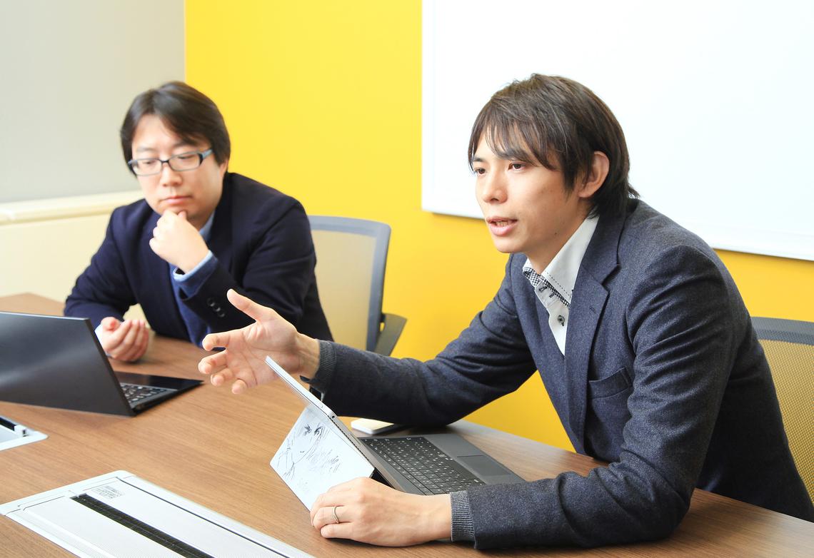 (左から)ネクステッジ電通の和田純一さん、データアーティスト代表の山本覚さん