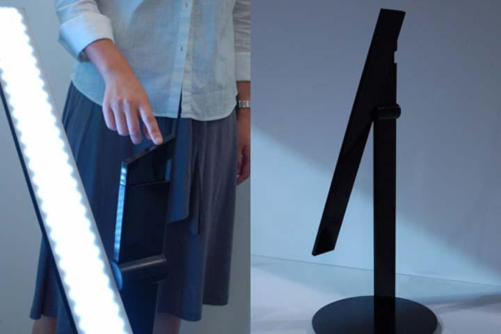 写真左のキューブを動かすと、ネットワークでつながったランプが点灯する。自分の好みの明るさ、位置を記録できる (Moodmark)-2